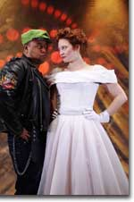Photo of Tony Molina as Petruchio and Sarah Fallon as Kate