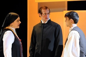 Haley Johnson as Marija, Casey Andree as Father Luka, and John Hauser as Young Stipan