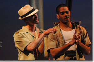(Left to right) Damion Hoover as Elegba and Laurence Curry as Oshoosi