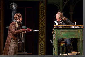 (Left to right) Brian Vaughn as Bob Cratchit and Sam Gregory as Ebenezer Scrooge