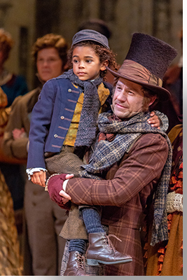 Lucas Turner as Tiny Tim and Brian Vaughn as Bob Cratchit