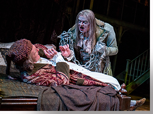 Sam Gregory as Ebenezer Scrooge and Jeffrey Roark as the Ghost of Jacob Marley