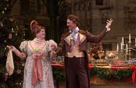 Photo of Kathleen M. Brady as Mrs. Fezziwig and Mark Rubald as Fezziwig
