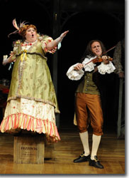 Leslie O'Carroll as Mrs. Fezziwig and Sam Gregory as A Fiddler