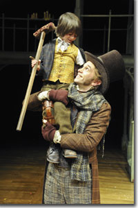 Charlie Korman as Tiny Time and Jeff Cribbs as Bob Cratchit