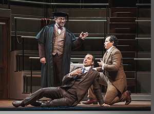 (Left to right) Patrick Carfizzi as Don Alfonso, David Adam Moore as Guglielmo, and Matthew Plenk as Ferrando