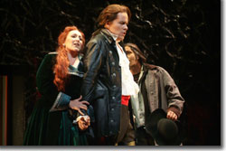 Emily Pulley as Donna Elvira, Jeff Mattsey as Don Giovanni, and Philip Cokorinos as Leporello