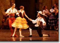 Photo of Igor Vassin (Basilio), Maria Mosina (Kitri) and Kevin Aydelotte (Don Quixote)