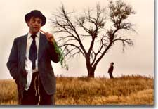 Photo of Gary Culig as Estragon (foreground) and Brett Aune as Vladimir (background)