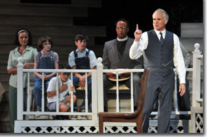 (Left to right) Tammy Meneghini as adult Jean Louise Finch (Scout), Ellie Schwartz as young Scout, Alex Rosenthal as Dill, Conner Shearrer as Jem, Bradley Spann as Reverend Sykes, and Sam Gregory as Atticus Finch