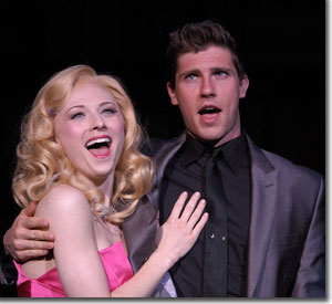 Hayley Podschun as Elle and Curt Hansen as Warner