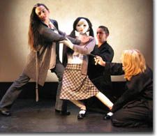 Photo of Karen Slack as Rebecca, the Rebecca puppet, and Melanie Owen Padilla and Leslie Randle Chapman as Puppeteers