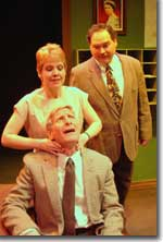 Photo of (front to rear) Fred Lewis as Henry Windscape, Suzanna Wellens as Melanie Garth, and Chuck Wigginton as St. John Quartermaine