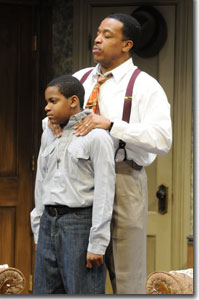 (Left to right) Tyler Palmer as Travis Younger and Russell Hornsby as Walter Lee Younger