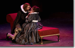 Sean Tarrant as the English Duke of Buckingham and Alexandra C. Lewis as Queen Anne of France explore mutual interests