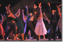 The dance at the gym in Central City Opera's WEST SIDE STORY (2008). Pictured (Center, L to R): Erin Webley (Graziella) and Chris Cobb Olsen (Riff).