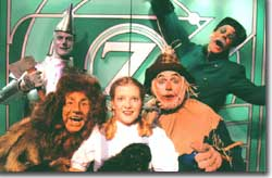 Photo of John Scott Slough as the Tin  Man, A.K. Klimpke as the Lion, Emily Van Fleet as Dorothy, Scott Beyette as the Scarecrow, Brian Norbr as the Gate Keeper, and Lyric as Toto
