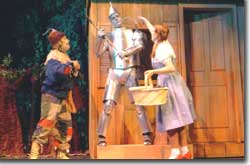 Photo of Scott Beyette as the Scarecrow, John Scott Clough as the Tin Man, and Emily Van Fleet as Dorothy